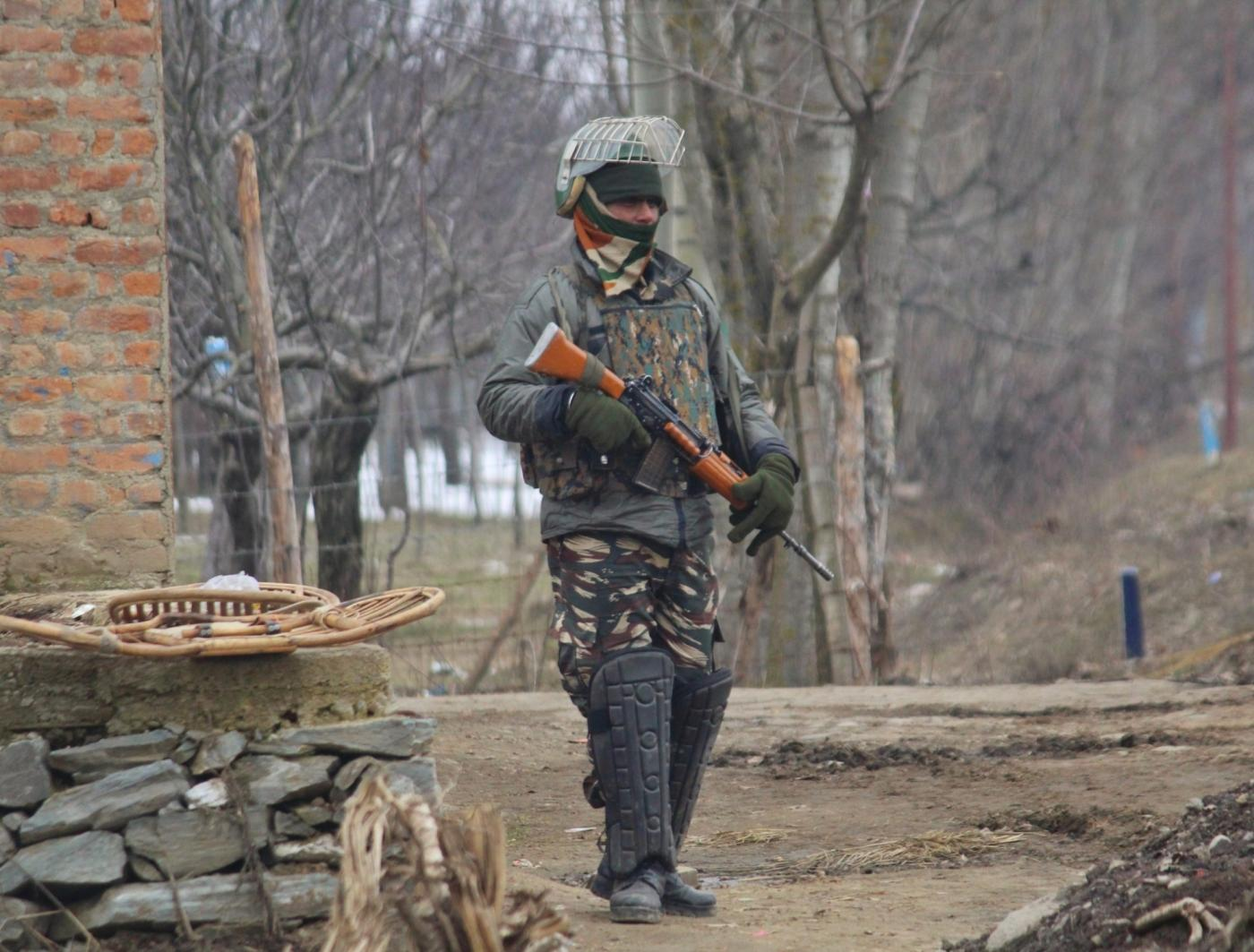 Kupwara: A soldier at the site of an encounter with militants in Jammu and Kashmir's Kupwara district on March 1, 2019. Two militants were killed in the gunfight. (Photo: IANS) by .