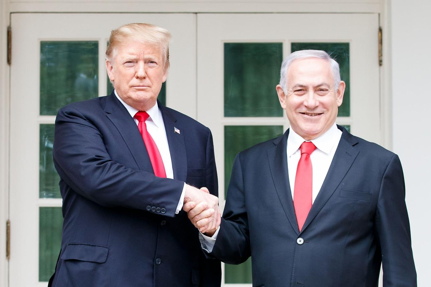 WASHINGTON, March 25, 2019 (Xinhua) -- U.S. President Donald Trump (L) shakes hands with Israeli Prime Minister Benjamin Netanyahu during their meeting at the White House in Washington D.C., the United States, on March 25, 2019. U.S. President Donald Trump on Monday signed a proclamation recognizing Israel's sovereignty over the disputed Golan Heights, territory that Israel seized from Syria in 1967. (Xinhua/Ting Shen/IANS) by .
