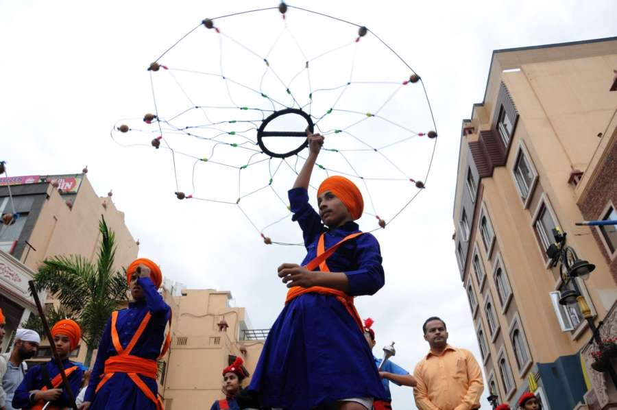 Amritsar: A Sikh 'Nihang' performs 'Gatka' during a procession taken out to mark the 100th anniversary of the 1919 Jallianwala Bagh massacre, in Amritsar on April 12, 2019. (Photo: IANS) by .