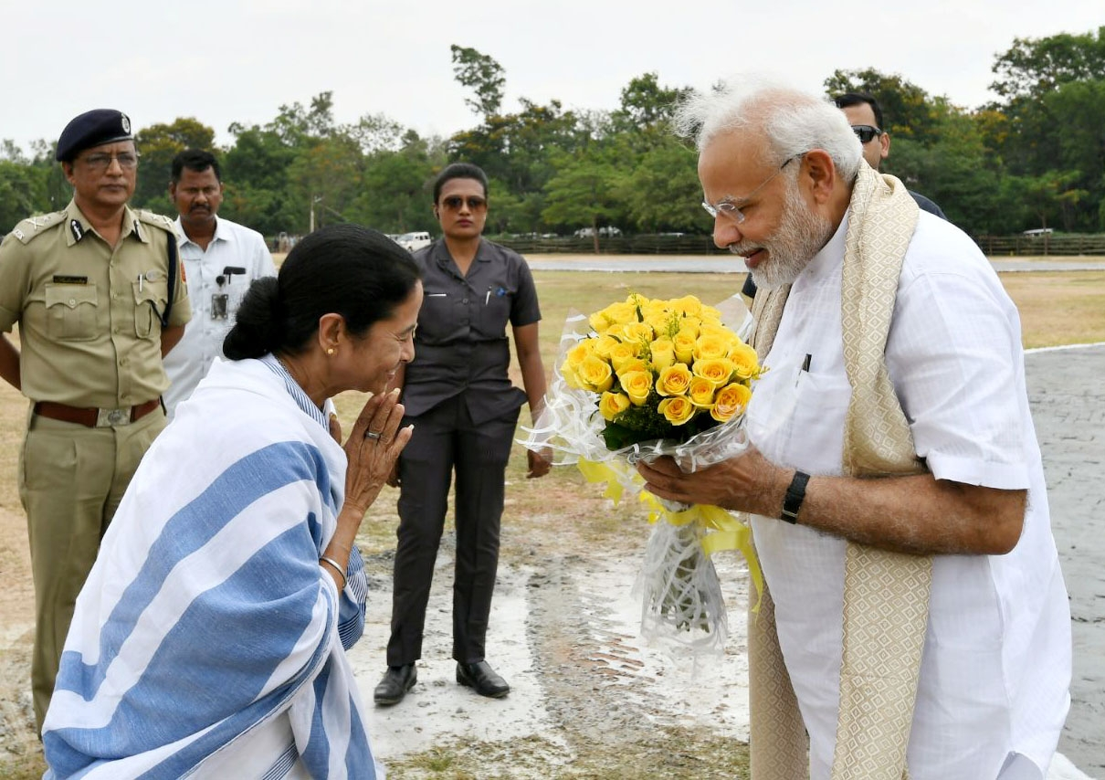Santiniketan: Prime Minister Narendra Modi being received by West Bengal Chief Minister Mamata Banerjee on his arrival at Santiniketan, in West Bengal on May 25, 2018. (Photo: IANS/PIB) by .