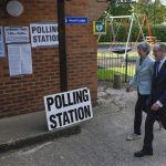 SONNING (BRITAIN), May 23, 2019 (Xinhua) -- British Prime Minister Theresa May (L) arrives to vote at a polling station in Sonning, Britain, on May 23, 2019. Voters across Britain cast their ballots on Thursday for the European Parliament elections as it is widely forecast that Brexit Party will take a lead. (Xinhua/Stephen Chung/IANS) by Stephen Chung.