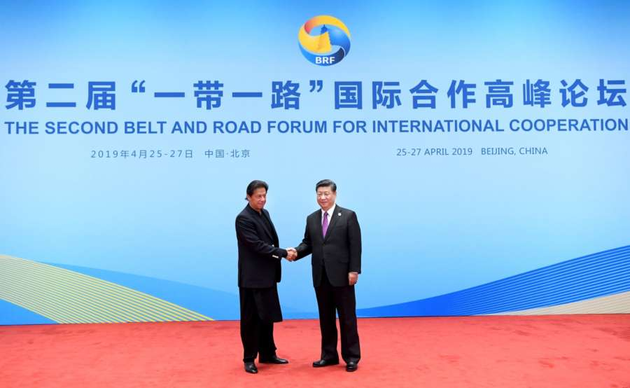 BEIJING, April 27, 2019 (Xinhua) -- Chinese President Xi Jinping shakes hands with Pakistani Prime Minister Imran Khan while welcoming foreign leaders and heads of international organizations attending the leaders' roundtable meeting of the Second Belt and Road Forum for International Cooperation at the Yanqi Lake International Convention Center in Beijing, capital of China, April 27, 2019. (Xinhua/Rao Aimin/IANS) by .