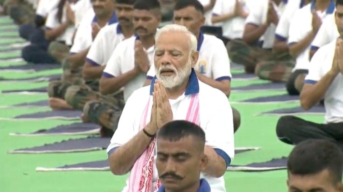 Ranchi: Prime Minister Narendra Modi practices yoga asanas -postures- on International Yoga Day 2019 at Prabhat Tara Maidan in Ranchi on June 21, 2019. (Photo: IANS) by .