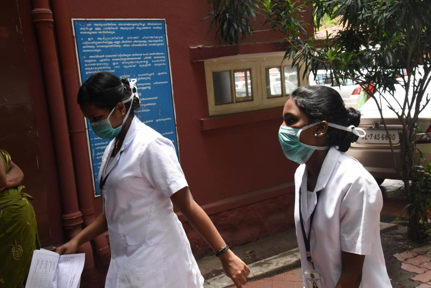 Ernakulam: Medical staff seen wearing masks at Ernakulam General Hospital. Kerala Health Minister K.K.Shailaja confirmed that the blood reports of a youth, suspected to be infected by the Nipah virus is positive on June 4, 2019. (Photo: IANS) by .