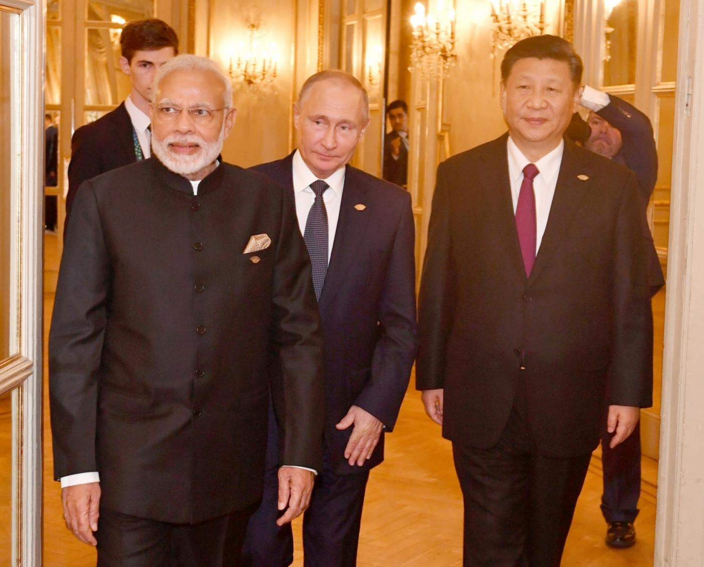 Buenos Aires: Prime Minister Narendra Modi, Russian President Vladimir Putin and Chinese President Xi Jinping at the RIC (Russia, India, China) Informal Summit, in Buenos Aires, Argentina on Nov 30, 2018. (Photo: IANS/PIB) by .