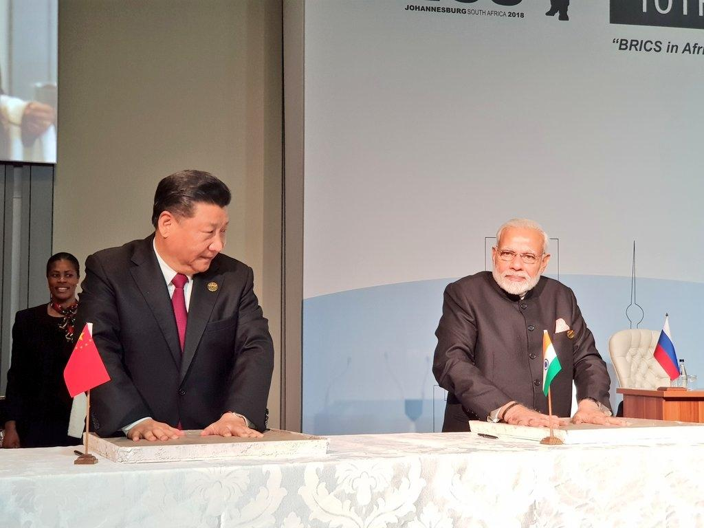 Maropeng: Prime Minister Narendra Modi and Chinese President Xi Jinping leave their hand impression on clay, for a symbolic demonstration of our connect to the Cradle of Humankind in Maropeng in South Africa on July 26, 2018. (Photo: IANS/MEA) by .
