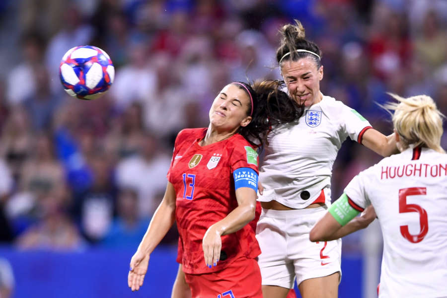 LYON, July 3, 2019 (Xinhua) -- Alex Morgan (L) of the United States and Lucy Bronze (C) of England head for the ball during the semifinal between the United States and England at the 2019 FIFA Women's World Cup at Stade de Lyon in Lyon, France on July 2, 2019. (Xinhua/Chen Yichen/IANS) by Chen Yichen.