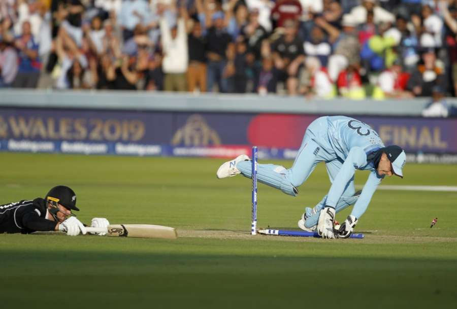 London: England's Jos Buttler dismisses Martin Guptill in the last ball of the super over to win the 2019 World Cup at Lord's Cricket Ground in London on July 15, 2019. (Photo: Surjeet Yadav/IANS) by .