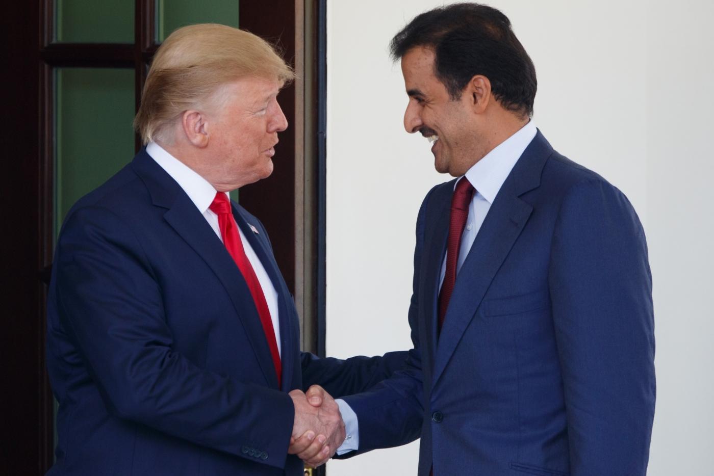 Washington, July 10, 2019 (Xinhua) -- U.S. President Donald Trump (L) welcomes Qatari Emir Sheikh Tamim Bin Hamad Al-Thani at the White House in Washington D.C., the United States, on July 9, 2019. (Xinhua/Ting Shen/IANS) by .