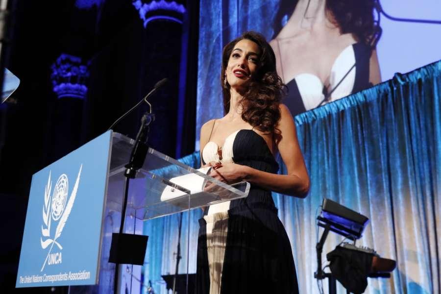 UNITED NATIONS, Dec. 7, 2018 (Xinhua) -- Human rights attorney Amal Clooney addresses the 2018 United Nations Correspondents Association (UNCA) Awards Gala, in New York, the United States, Dec. 5, 2018. (Xinhua/Li Muzi/IANS) by .