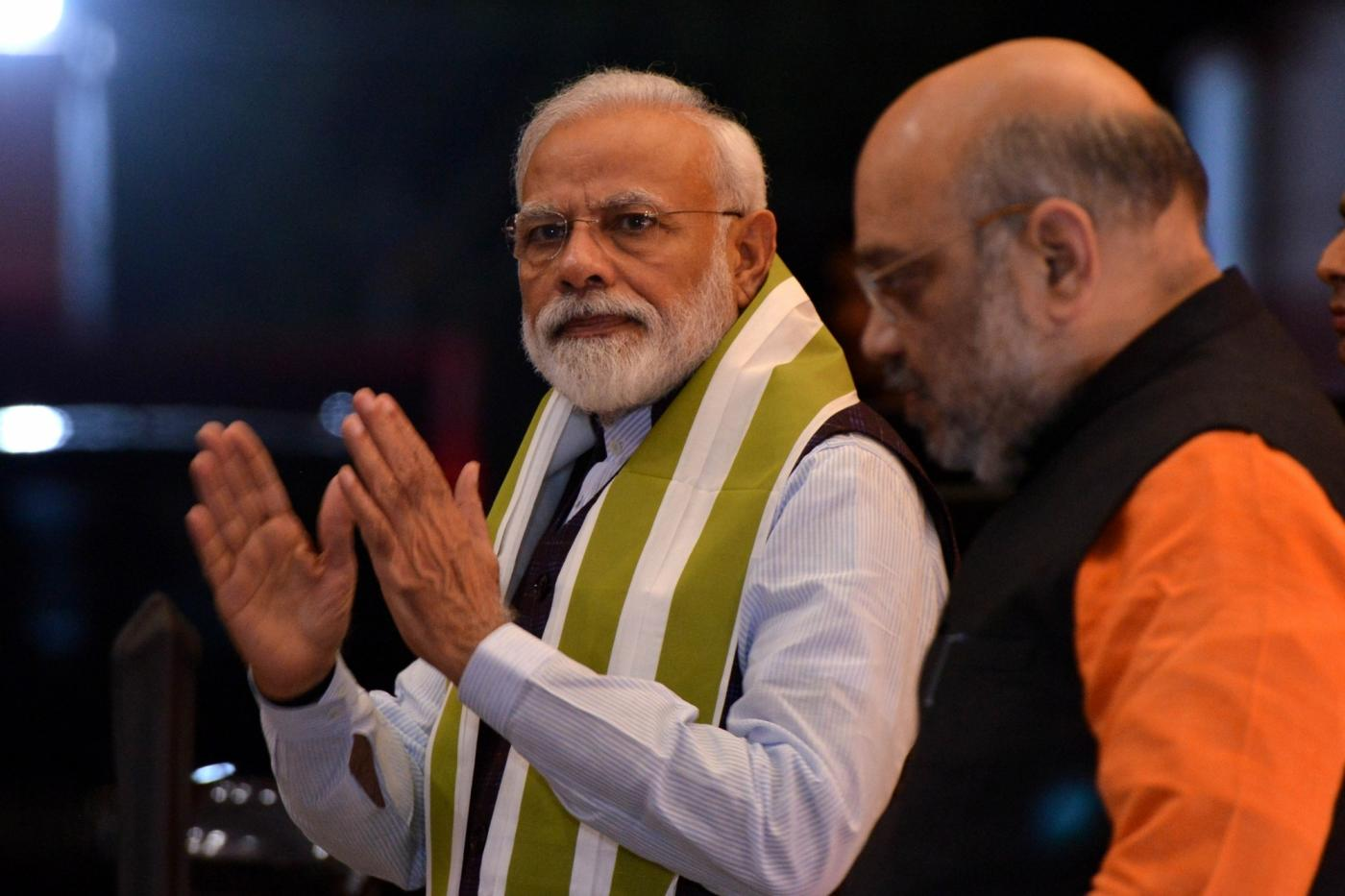 New Delhi: Prime Minister Narendra Modi and BJP President Amit Shah arrive at BJP headquarters to attend party's central election committee meeting in New Delhi, on March 20, 2019. (Photo: IANS) by .