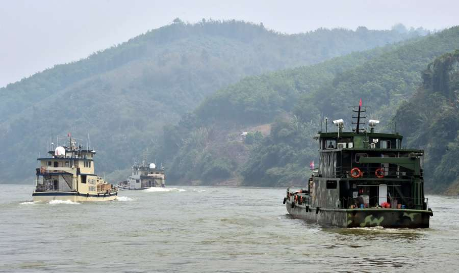 BEIJING, Nov. 21, 2018 (Xinhua) -- Joint patrol vessels with law enforcement personnel from China, Thailand, Laos and Myanmar, sail on the Lancang-Mekong River, March 17, 2015. The 76th Mekong River joint patrol led by China, Laos, Myanmar, and Thailand started Nov. 20, 2018 from Guanlei Port, Xishuangbanna Dai Autonomous Prefecture in southwest China's Yunnan Province. According to Yunnan border police bureau, the joint patrol will last five days and cover a range of over 500 kilometers to enhance anti-terrorism capability, safeguard the security and crack down on cross-border crimes. Once every month since 2011, the patrols targeting drug trafficking, smuggling and other cross-border crimes along the Mekong, conduct random inspections in waters near key regions, including the Golden Triangle.The Mekong River, known as the Lancang River at the Chinese stretch, runs through China, Laos, Myanmar, Thailand, Cambodia and Vietnam. It is an important waterway for transnational shipping and a border area known for criminal activities. For seven years, security cooperation between the four countries has been getting closer with joint patrols a regular monthly phenomenon. The patrol includes anti-terrorism drills, police skill practices and anti-drug campaigns. Since December 2011, the joint patrols have covered more than 39,500 kilometers, with 122 merchant ships rescued and 582.28 kilograms of drugs seized. The cooperation has expanded to the cracking down on terrorism and human trafficking, as well as joint search and rescue. (Xinhua/Chen Haining/IANS) by .
