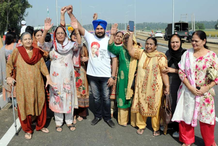 Dera Baba Nanak: Pilgrims shout religious after paying obeisance at Gurdwara Kartarpur Sahib ahead of the signing ceremony of the operationalising modalities agreement between India and Pakistan for the Kartarpur Corridor to allow Indian pilgrims to visit the holy shrine throughout the year, at Kartarpur Sahib Corridor Zero Point, International Border in Punjab's Dera Baba Nanak on Oct 24, 2019. (Photo: IANS) by .