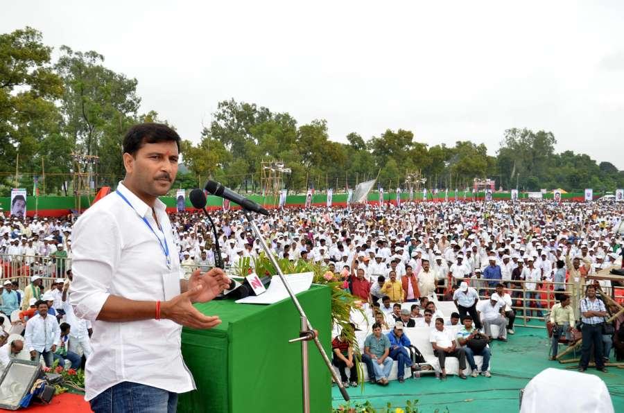 All Jharkhand Students Union (AJSU) chief Sudesh Mahato addresses a rally at Prabhat Tara ground of Ranchi, on Sept. 21, 2014. (Photo: IANS) by .