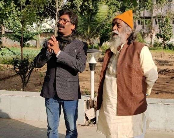 Ranchi: Jharkhand Mukti Morcha (JMM) leader Hemant Soren with his father and party chief Shibhu Soren during his visit to the latter's residence to seek his blessings, during the counting of votes for the Jharkhand Assembly elections, at Morabadi ground in Ranchi on Dec 23, 2019. Leaving the BJP behind, the Jharkhand Mukti Morcha (JMM) has emerged as the single largest party in the state assembly elections in the state, with 29 leads so far. The Congress, JMM and Rashtriya Janata Dal alliance is all set to form the government as per emerging trends of the Election Commission. (Photo: IANS) by .