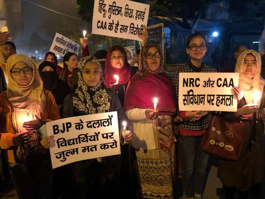 New Delhi: Muslim women participte in a candle light march to protest against Citizenship Amendment Act (CAA) 2019 and the NRC, in New Delhi on Dec 17, 2019. (Photo: IANS) by .
