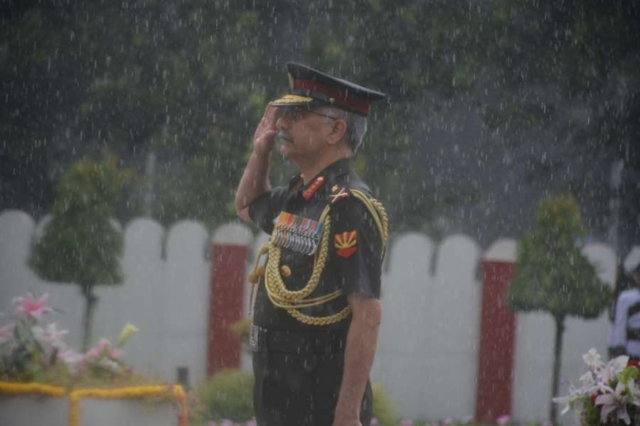 Kolkata: Eastern Army Commander Lt Gen Manoj Mukund Naravane pays tributes to the martyrs during rains, on the 20th Anniversary of Kargil Vijay Diwas, in Kolkata on July 26, 2019. (Photo: IANS) by .