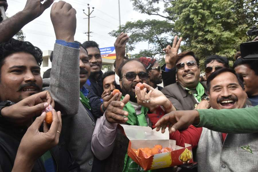 Ranchi: Jharkhand Mukti Morcha (JMM) workers celebrate the party's performance in the state assembly elections as counting is underway, in Ranchi on Dec 23, 2019. The grand alliance of the JMM-Cong-RJD has managed to take early lead over the BJP in Jharkhand Assembly elections as per the early trends and is likely to form the next government in the mineral rich state. (Photo: IANS) by .