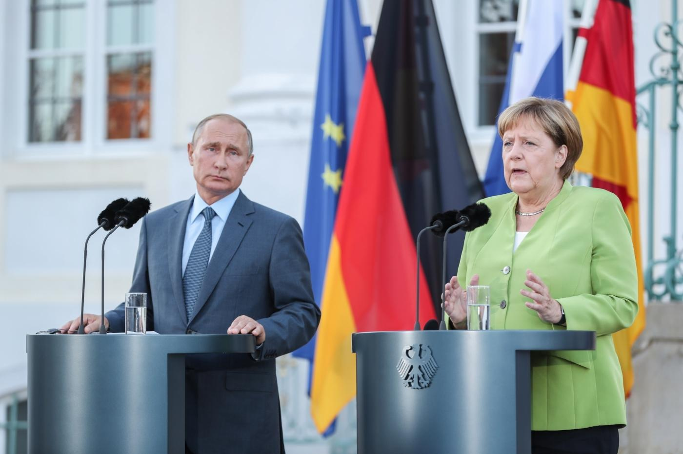 MESEBERG (GERMANY), Aug. 18, 2018 (Xinhua) -- German Chancellor Angela Merkel (R) and visiting Russian President Vladimir Putin attend a joint press conference at the Schloss Meseberg, north of Berlin, Germany, on Aug. 18, 2018. German Chancellor Angela Merkel and Russian President Vladimir Putin held talks in north of Berlin on Saturday, with the topics ranging from Syria, Ukraine, Iran as well as the Nord Stream 2 gas pipeline project. (Xinhua/Shan Yuqi/IANS) by .
