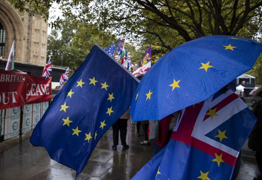 LONDON, Oct. 17, 2019 (Xinhua) -- Protestors demonstrate outside the Houses of Parliament in London, Britain, Oct. 17, 2019. The Northern Irish Democratic Unionist Party (DUP) on Thursday rejected Prime Minister Boris Johnson's Brexit draft, despite it just being agreed with the European Union, making it difficult to get approved by the British parliament. (Xinhua/Han Yan/IANS) by .