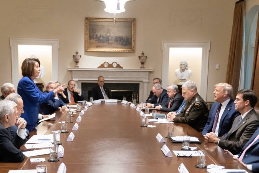 Signifying the deep political divisions in Washington, a new photo shows US House Speaker Nancy Pelosi confronting President Donald Trump at a reportedly explosive White House meeting. In the image, leading Democrat Pelosi is standing up at a large table, surrounded by male Congressional leaders and top military officials, pointing her finger towards the President, who is seated opposite her and appears stunned. by .