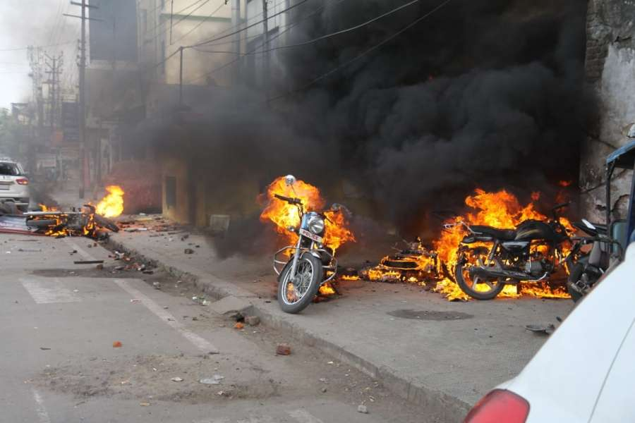 Lucknow: Angry protesters went on rampage and set ablaze vehicles during their protest against the Citizenship Amendment Act (CAA) 2019, in Lucknow on Dec 19, 2019. Violence erupted during protests against CAA on Thursday afternoon in various cities of Uttar Pradesh, including the state capital. Roadways buses were set on fire by protesters in Sambhal district and some private vehicles were also set ablaze. Internet services have been suspended in the western UP district. (Photo: IANS) by .