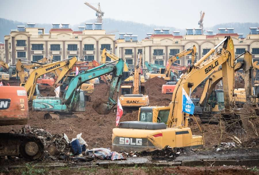 """WUHAN, Jan. 24, 2020 (Xinhua) -- Photo taken on Jan. 24, 2020 shows mechanical equipment working at the contruction site of a special hospital in the Caidian District of western suburb of Wuhan, central China's Hubei Province. The central China metropolitan of Wuhan will follow Beijing's SARS treatment model to build a special hospital for admitting patients infected in the outbreak of pneumonia caused by the novel coronavirus. The Wuhan headquarters for the control and treatment of pneumonia caused by the novel coronavirus said on Friday the upcoming hospital designed to have an area of 25,000 square meters will be put into use by Feb. 3.TO GO WITH """"China Focus: Wuhan to follow Beijing's SARS treatment model in new coronavirus control"""" (Xinhua/Xiao Yijiu/IANS) by ."""