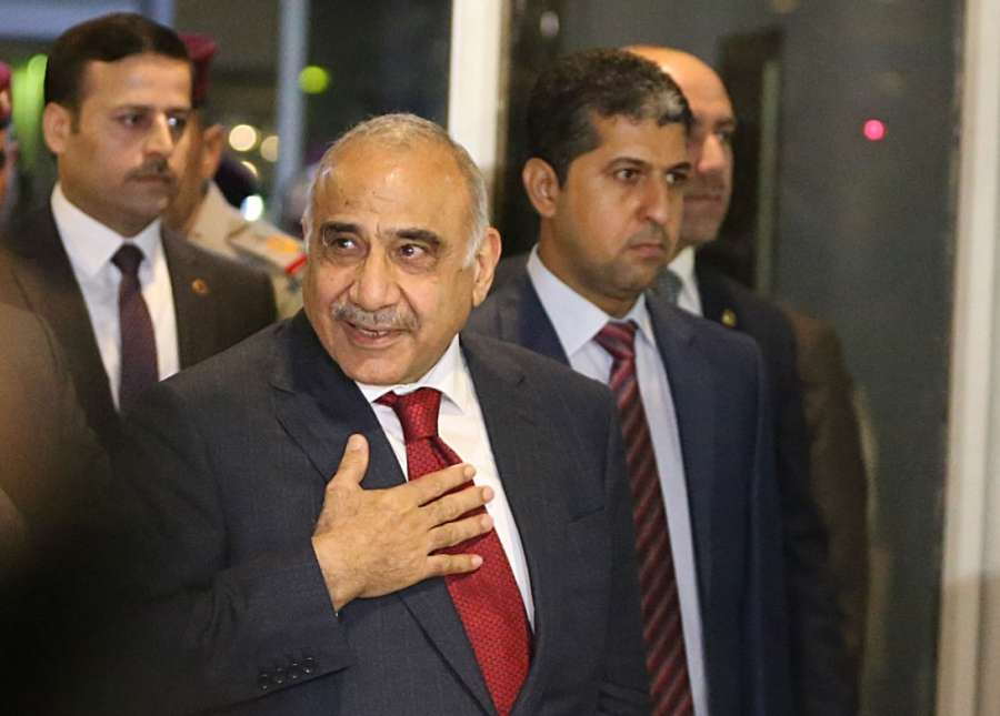 BAGHDAD, Oct. 24, 2018 (Xinhua) -- Adel Abdul Mahdi (Front) arrives at the parliament in Baghdad, Iraq, on Oct. 24, 2018. Adel Abdul Mahdi on Wednesday was sworn in as new prime minister of Iraq after the parliament passed 14 out of his 22 cabinet members. (Xinhua/IANS) by .