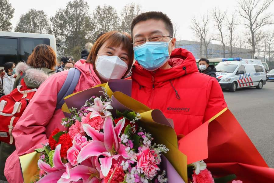 BEIJING, Jan. 26, 2020 (Xinhua) -- Ma Jun (L), a member of a medical team, says goodbye to her husband Chen Sen before leaving for Wuhan of Hubei Province at Beijing Capital International Airport in Beijing, capital of China, on Jan. 26, 2020. A 121-member medical team, organized by the National Health Commission, left Beijing for Wuhan Sunday afternoon to aid the coronavirus control efforts there. (Xinhua/Zhang Yuwei/IANS) by .