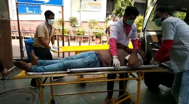 New Delhi: A person who sustained injuries during violent clashes between pro- and anti-CAA protesters in northeast Delhi, being brought at GTB Hospital for medical treatment, on Feb 25, 2020. More than 15 people have sustained bullet injuries. in the clashes. (Photo: IANS) by .