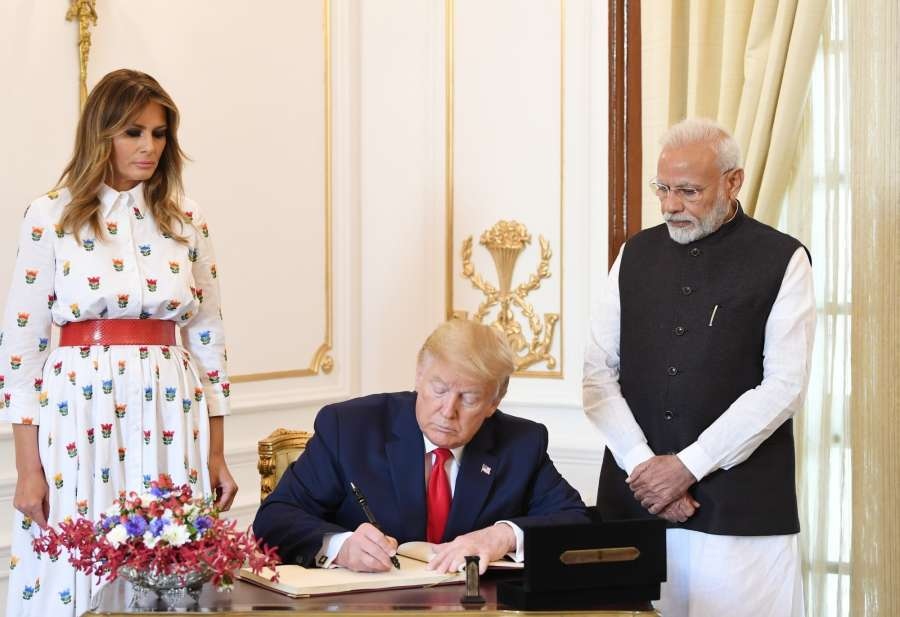 New Delhi: US President Donald Trump signs the Visitors Book of Hyderabad House as First Lady Melania Trump and Prime Minster Narendra Modi look on, in New Delhi on Feb 25, 2020. (Photo: IANS/PIB) by .
