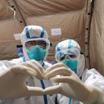 "WUHAN, Feb. 14, 2020 (Xinhua) -- Mobile photo taken on Feb. 14, 2020 shows Gao Yongzhe (L) and Huang Wenli posing for a photo gesturing a heart-shaped sign at ""Wuhan Livingroom"" in Wuhan, central China's Hubei Province. Doctor Gao Yongzhe and nurse Huang Wenli are a couple working at the frontline against the novel coronavirus. Although they both spend all day at ""Wuhan Livingroom"", a temporary hospital, the busy couple barely had time to meet each other. On Feb. 14, under the arrangement of the hospital, the couple met and had a lunch together. As Huang put it, it was their special and meaningful 23rd Valentine's Day even though there was no flower and gift. (Photo by Gao Xiang/Xinhua/IANS) by ."