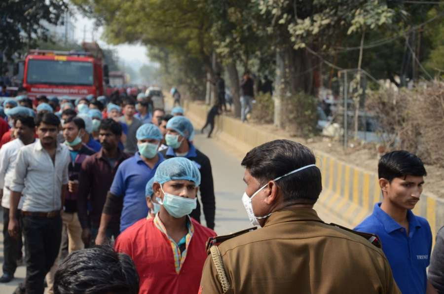 Noida: Workers of Haldiram's factory in Sector 65 being evacuated after an ammonia gas leak was reported at the factory, killing a person, on Feb 1, 2020. (Photo: IANS) by .