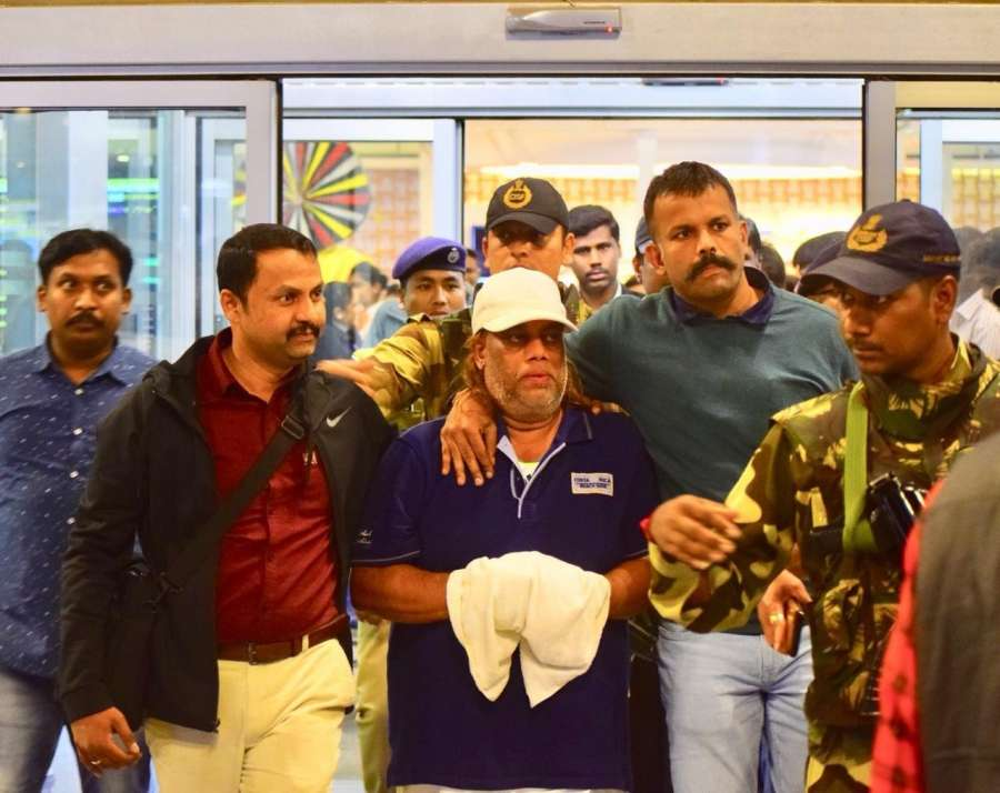 Bengaluru: Ravi Pujari (wearing white cap), accused of committing serious offences including murder and extortion, reaches Kempegowda International Airport. by .