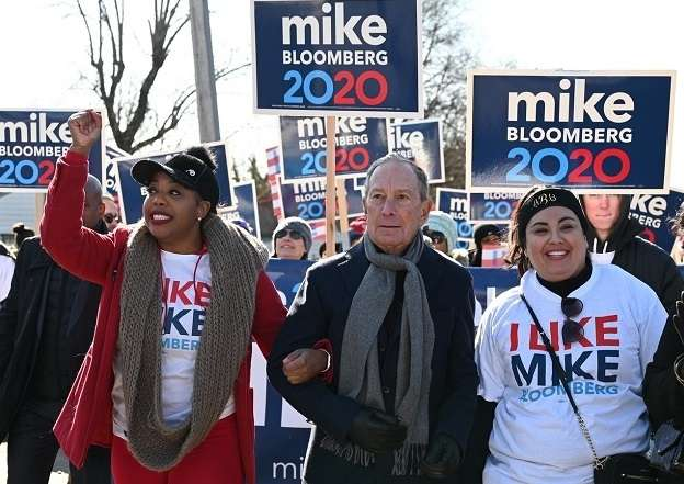 Candidate for the Democratic Party's presidential nomination, Mike Bloomberg, marches in a parade honouring civil rights leader Martin Luther King in Little Rock, Arkansas, in January 2020. (Photo: Bloomberg campaign) by .