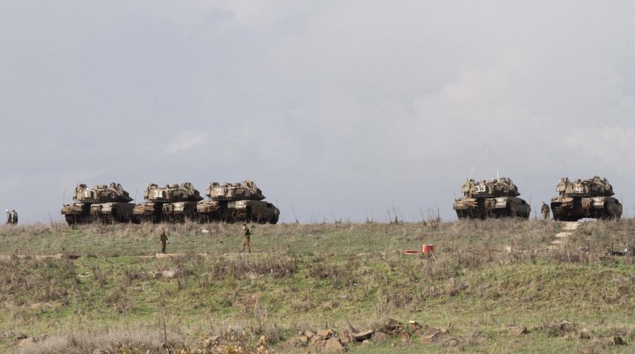 GOLAN HEIGHTS, Dec. 31, 2019 (Xinhua) -- Israeli soldiers and military tanks are seen in the Israeli-occupied Golan Heights during a military drill on Dec. 30, 2019. The Israeli military was in a state of high alert in the Golan Heights, in readiness for possible retaliation by Iran after U.S. strikes on Kata'ib Hezbollah facilities in Iraq and Syria Sunday. (Photo by Gil Cohen Magen/Xinhua/IANS) by .