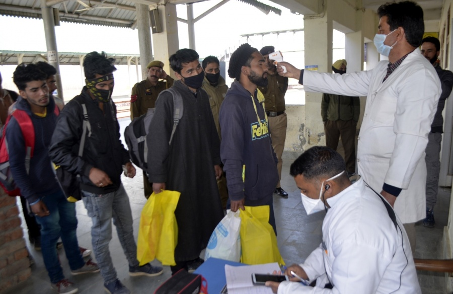 Baramulla: Passengers being screened for COVID-19 at Baramulla railway station amid coronavirus pandemic, in Jammu and Kashmir's Baramulla on March 18, 2020. (Photo: IANS) by .