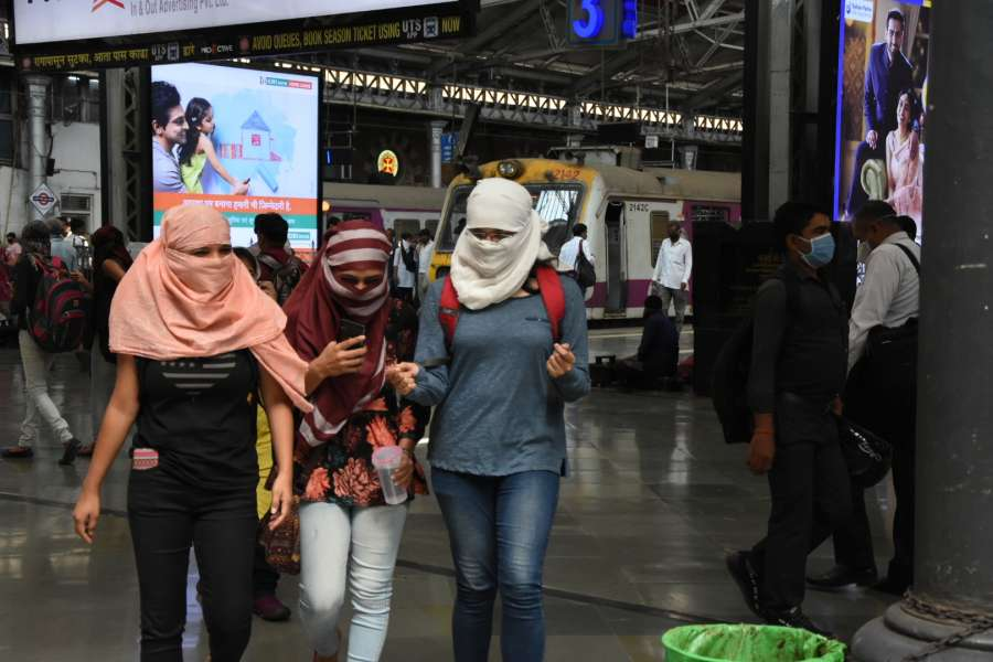 Mumbai: Women seen covering their faces as a measure to contain the spread of COVID-19 (coronavirus), in Mumbai on March 21, 2020. (Photo: IANS) by .