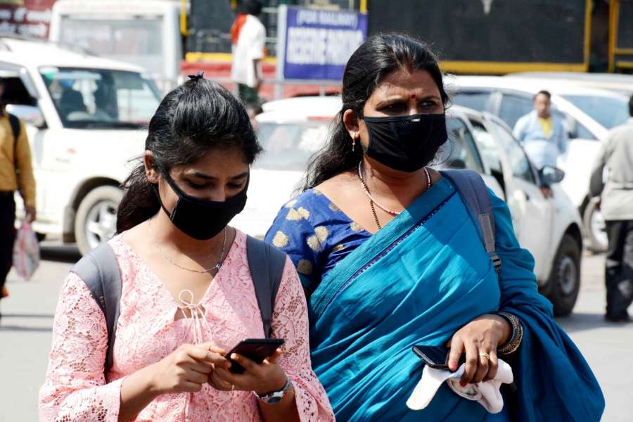 Patna: People wear masks as a precautionary measure against COVID-19 amid coronavirus pandemic, in Patna on March 20, 2020. (Photo: IANS) by .