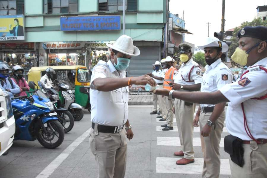 Bengaluru: Bengaluru Traffic police personnel awareness campaign for public using sanitation and hand wash COVID-19 (coronavirus) outbreak in Bengaluru on March 20, 2020 (Photo: IANS) by .