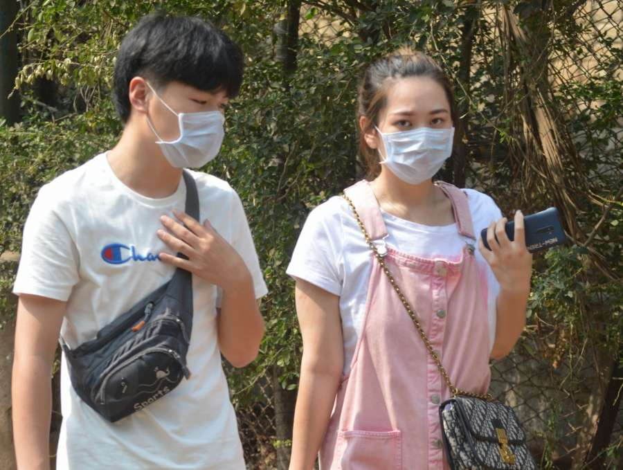 Bengaluru: People seen wearing masks as a precautionary measure against Coronavirus, in Bengaluru on March 4, 2020. (Photo: IANS) by .