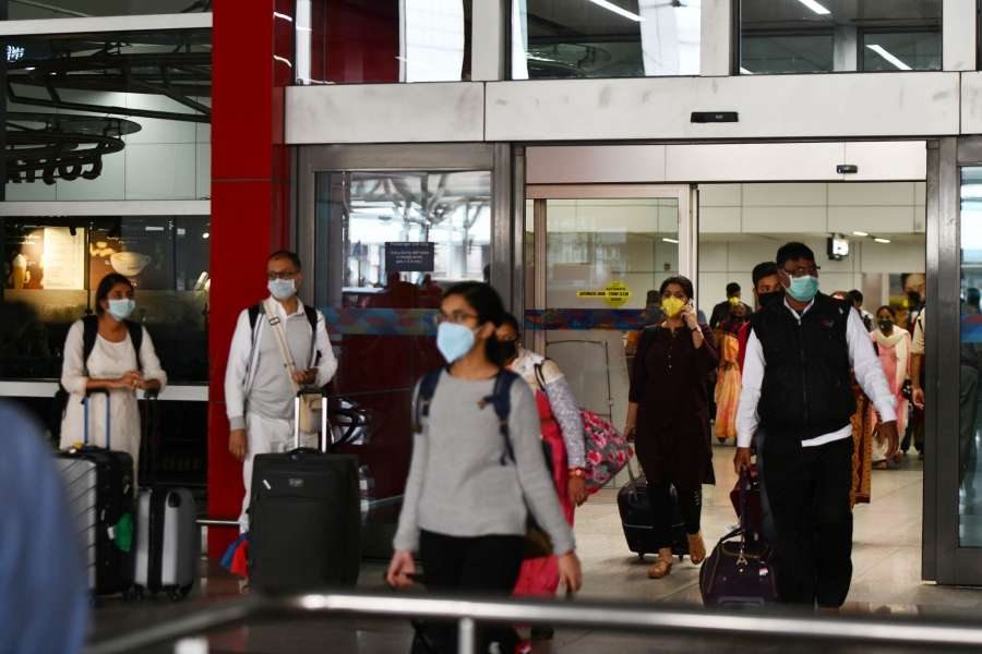 New Delhi: Passengers seen wearing masks as a precautionary measure against COVID-19 (Coronavirus) at the Indira Gandhi International Airport in New Delhi on March 15, 2020. (Photo: IANS) by .