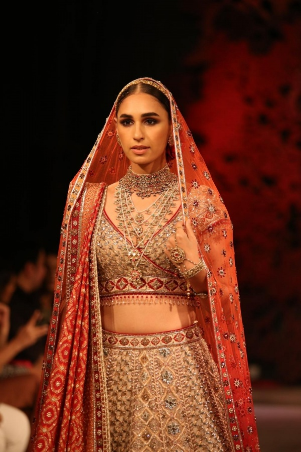 New Delhi: A model showcases fashion designer Tarun Tahiliani's creations at the India Couture Week 2019 in New Delhi, on July 28, 2019. (Photo: Amlan Paliwal/IANS) by .