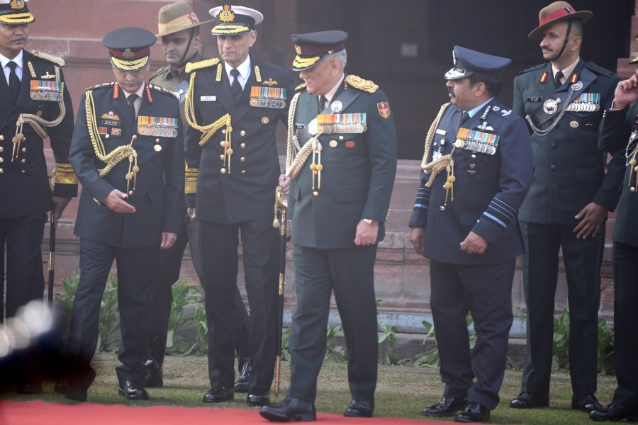 New Delhi: General Bipin Rawat with Army Chief Manoj Mukund Naravane, Air Chief Marshal Rakesh Kumar Singh Bhadauria and Navy Chief Karambir Singh during a guard of honour accorded to him by all the three forces as he took charge as India's first Chief of Defence Staff, in New Delhi on Jan 1, 2020. (Photo: IANS) by .