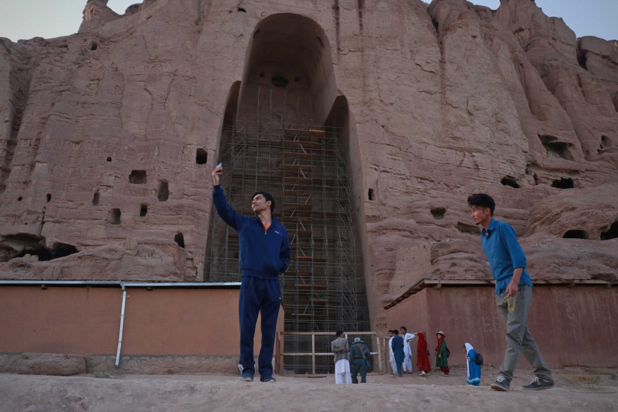 BAMYAN, Aug. 17, 2019 (Xinhua) -- A tourist takes selfies in front of the ruined Buddha statue in Bamyan province, Afghanistan, Aug. 16, 2019. (Photo by Noor Azizi/Xinhua/IANS) by .