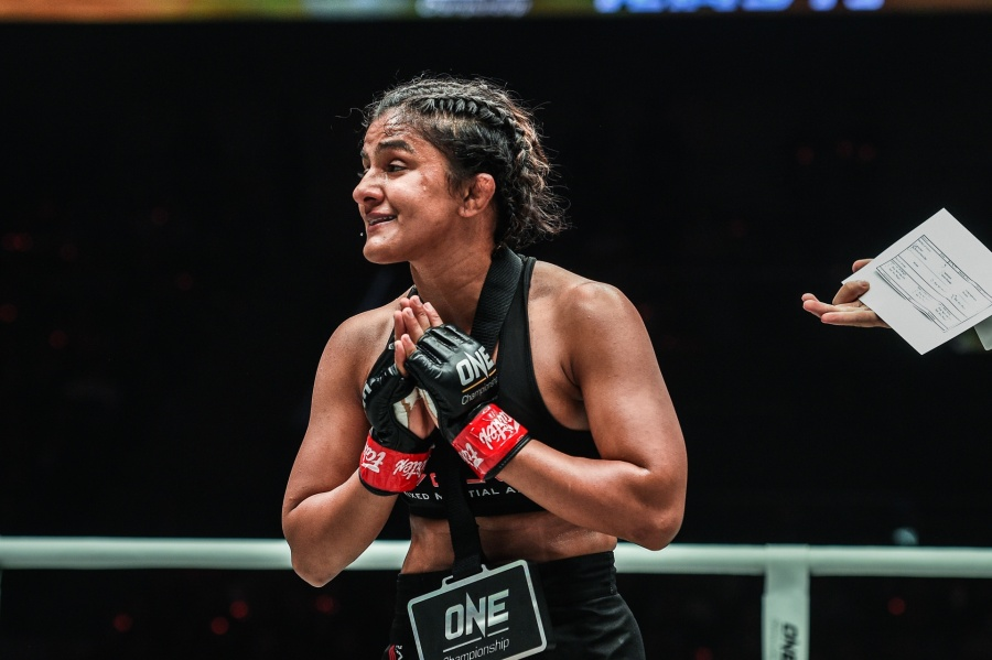 Beijing: India's Ritu Phogat, who made her debut in mixed martial arts (MMA), celebrates after winning against South Africa's Kim Nam-hee at One Championship's Age of Dragons in Beijing on Nov 16, 2019. (Photo: IANS) by .