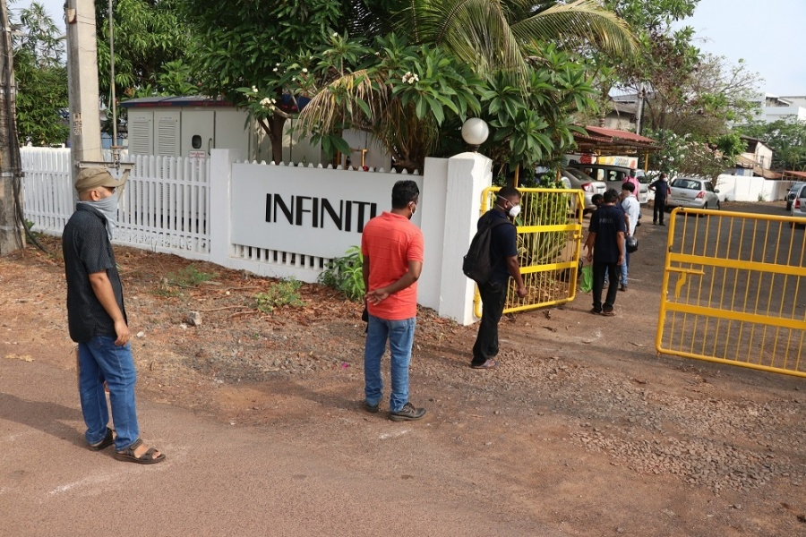 Pilerne: Industry workers queue up at the entrance of their work premises at Pilerne Industrial Estate in Goa's Pilerne for the thermal screening of COVID-19 as they get back to work on the first day of curfew relaxation during the extended nationwide lockdown imposed to mitigate the spread of coronavirus; on Apr 20, 2020. (Photo: IANS) by .