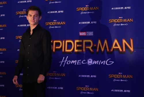 """Seoul: Hollywood actor Tom Holland, who stars in the new movie """"Spider-Man: Homecoming,"""" poses for a photo during a publicity event in Seoul on July 3, 2017. The movie will be released in South Korea on July 5. (Yonhap/IANS) by ."""