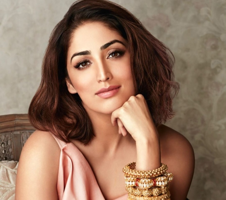 Yami Gautam starts her Monday flaunting a modern yet traditional avatar. The Bollywood beauty posted a picture of her on Instagram where she is seen in a modern peach-coloured dress, which she has teamed up with traditional heavy gold bangles. Yami has chosen to keep her makeup minimal using nude shades of lipstick and eye shadow and she looks stunning. by .