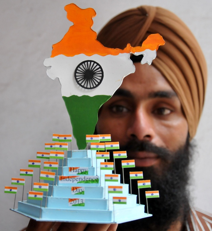 Paper artist Gurpreet Singh showing Indian map and flags made of paper for forthcoming Independence Day celebrations in Amritsar on August 13, 2013. (Photo::: IANS) by .